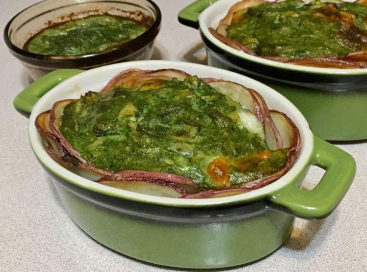 potato slices with spinach, artichoke & brie